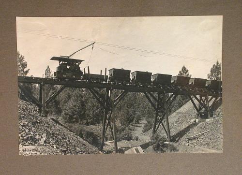 Photograph of North Star Mining Company train on bridge