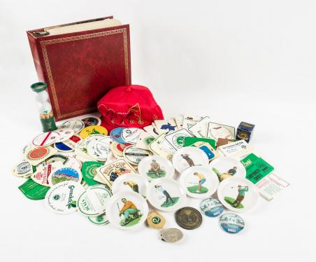 Collection of miscellaneous golf collectibles, bag tags, patches, score...