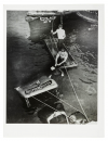 Untitled [Police officer and assistant removing body of Reception Hospital ambulance driver Morris Linker from East River, New York]