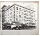 Realtor's album of photographs of Oakland buildings, c.1927, a number stating the rise in value over the preceding decade