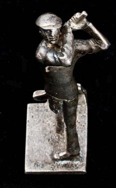 Silver business card holder with figurine of a golfer